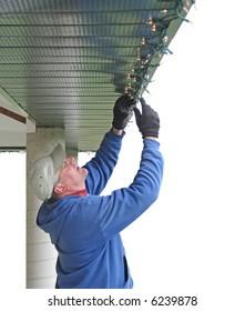 Man installing Christmas lights
