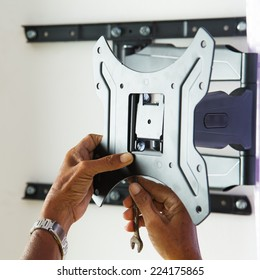 Man installing mount TV on the wall at home