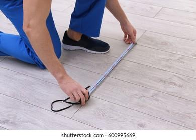 Man installing new wooden laminate flooring