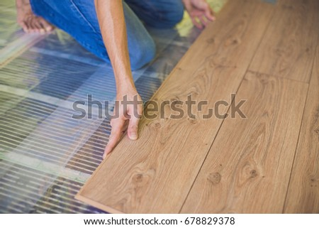 Man Installing New Wooden Laminate Flooring Stock Photo Edit Now