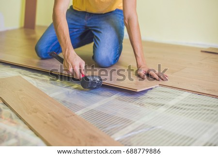 Man Installing New Wooden Laminate Flooring Stock Photo Edit Now