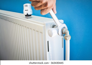 Man installing radiator valve close up