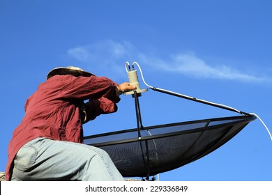 a man installing the satellite dish