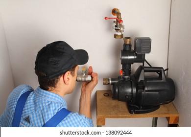 Man installing a water pump