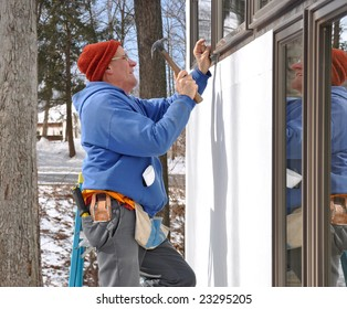 Man installing window in new addition