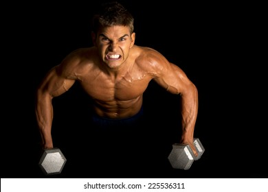 a man with an intense expression on his face, doing a push up on weights.