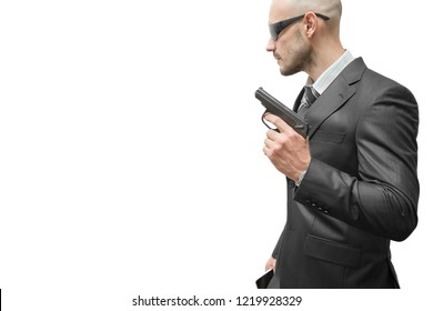 A man in a jacket holds a gun in his hand. Focus on the gun