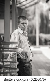the man in the jacket on the street. portrait