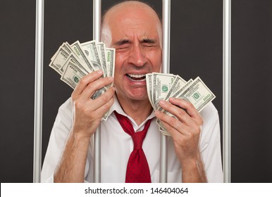 Man in jail crying and holding cash