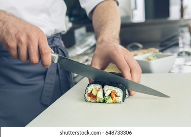 Man japanese restaurant chef cooking in the kitchen