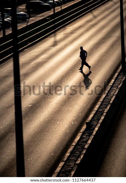 A Man jaywalking Cross The Road