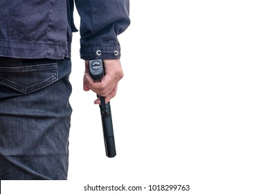 Man in a jeans holding a gun isolated on white. cropped shot of man holding gun in hand.