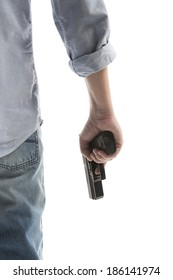 Man in a jeans holding a gun isolated on white