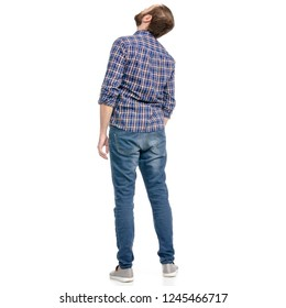 A man in jeans looking up on a white background isolation back view