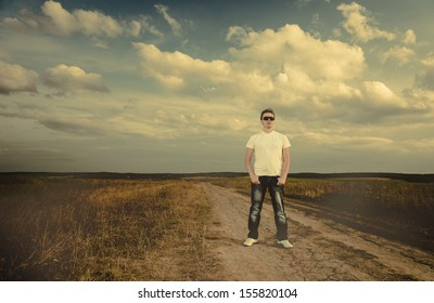 man in jeans on a rural road