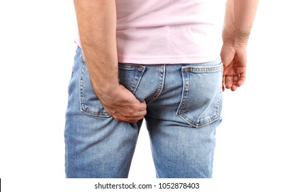 Man in jeans scratching hand his itchy ass