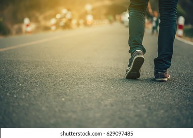 Man jeans and sneaker shoes walking