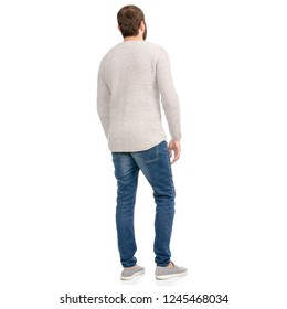 A man in jeans sweater looking on a white background isolation back view