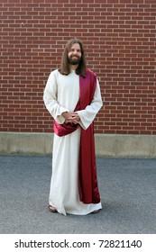 Man in Jesus Christ robe and sash