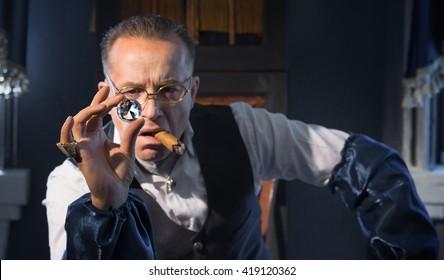 The man - a jeweler examines jewelry