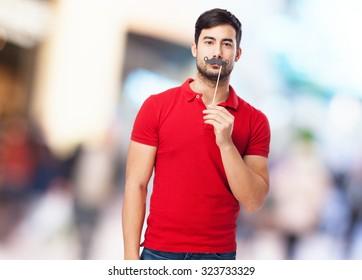 man joking with mustache