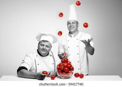 A man jugglering tomato