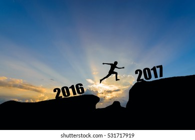 man jump between 2016 and 2017 years on sunset background.