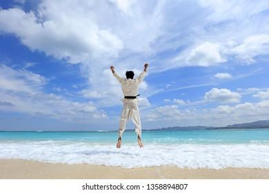 Man jump on beach.