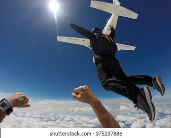 Man jump of plane, skydiving point of view.