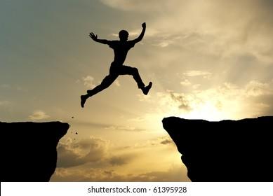 Man jump through the gap. Element of design.