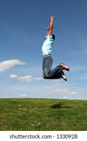 Man jumping against blue sky