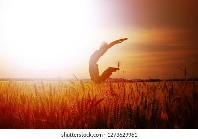 man jumping. farmer in the field. landscape field. wheat field.