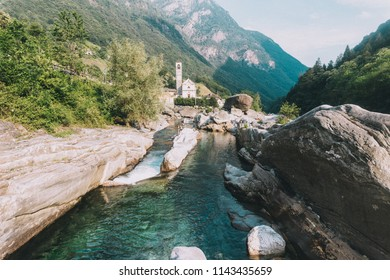 Man jumping into the river Versasca River in Lavertezzo, Ticino