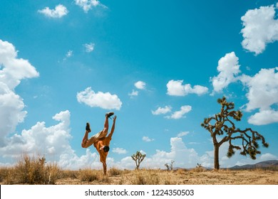 Man jumping like Joshua Tree. Amazing day over Joshua Tree National Park. Desert landscape.