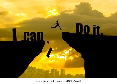 Man jumping on I can do it or I can't do it text over cliff on sunset background,Business concept idea