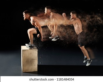 Man jumping on fit box in gym. Male with naked torso exercises jump on the dark background