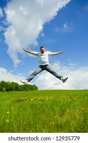 The man jumping on a lawn