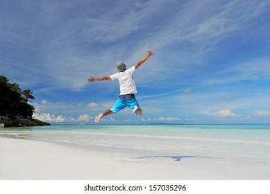 A Man Jumping on a Tropical White Sand Beach of Tachai Island, Similan Islands National Park, Phang Nga, Thailand