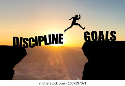Man jumping over abyss with text DISCIPLINE/GOALS.