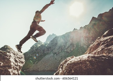 Man jumping to the sun in rocky mountains Travel Lifestyle happiness and success motivation concept adventure summer vacations outdoor mountaineering sport