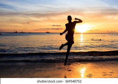 Man jumping  at Sunset on beach in Santiago island in Cape Verde - Cabo Verde