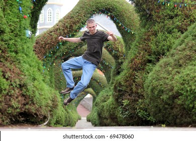 Man jumps in the air and clicks his feet together