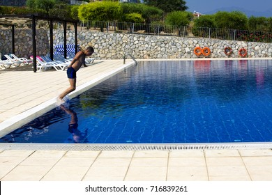 Man jumps into the pool in Cyprus