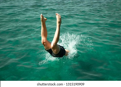 A man jumps into the water