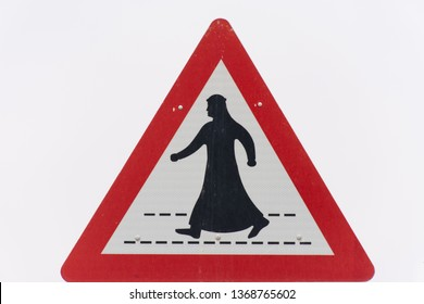 Man in Kandora Crossing the street sign in the United Arab Emirates (UAE) on a white background.