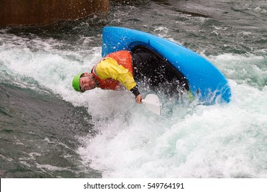 Man in kayak about to capsize in rough water and get very wet