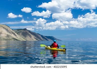 The man in a kayak on Lake Baikal