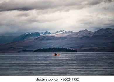 A man kayaking at Lake Tekapo, New Zealand