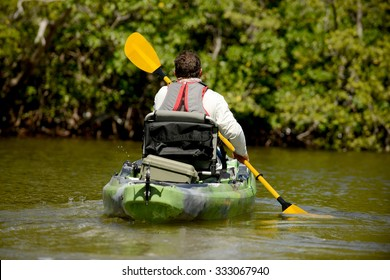 man kayaking in mangroves in florida