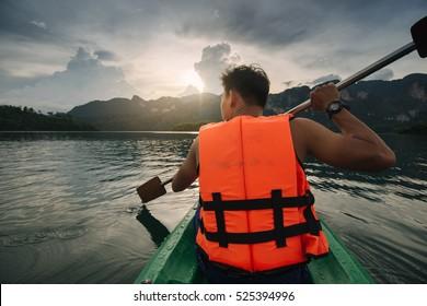 man kayaking on lake  Suratthani Thailand.